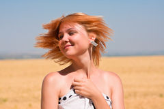 Young girl flapping her ginger hair Stock Image