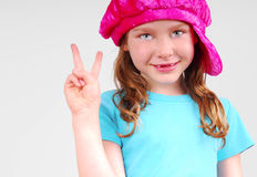 Young girl flashing peace sign Stock Photography