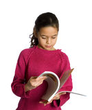A young girl flipping through her book Stock Photos