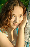 Young girl flirt. Young girl with curly hair flirt Stock Photo