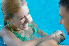 Young girl flirting with a boy at the pool Royalty Free Stock Photos