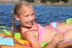 Young Girl Floating in a River Royalty Free Stock Photo