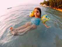 Young girl floating in shallow water Stock Image