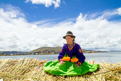 Young girl on a floating Uros island, Titicaca