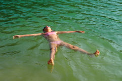 Young girl floating on water Stock Photo