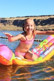 Young Girl on a Floaty Stock Photos