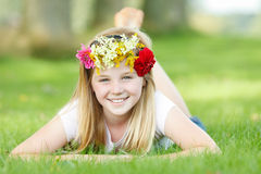 Young girl with floral wreath outdoor smiling Royalty Free Stock Images
