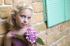 Young girl with a flower Royalty Free Stock Images