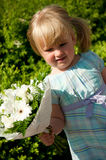 Young girl with flower bouquet Stock Images