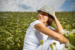 Young girl in a flower field Royalty Free Stock Images