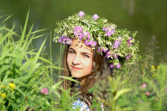 Young girl with flower garland Stock Photo
