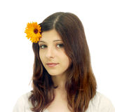 A young girl with a flower in her hair Stock Photo