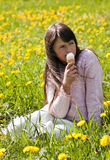 Young girl in a flower meadow stock photos