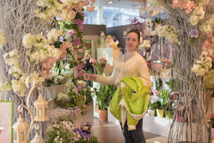 Young girl in a flower shop Stock Images