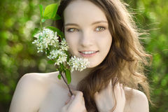 Young girl flower smile portrait outdoor Royalty Free Stock Photos