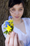 Young Girl with flowers Royalty Free Stock Photo