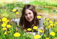 Young girl among the flowers Royalty Free Stock Photography
