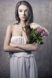 Young girl with flowers Royalty Free Stock Photos