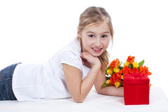 Young girl with flowers and gift box Royalty Free Stock Image