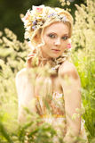 Young girl and flowers in her hair Stock Photography