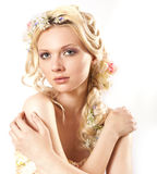 Young girl and flowers in her hair Stock Photos