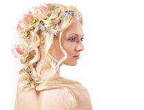 Young girl and flowers in her hair Royalty Free Stock Photography