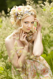 Young girl and flowers in her hair Royalty Free Stock Image