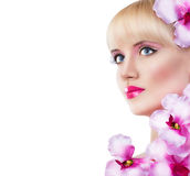 Young girl with flowers and perfect makeup Stock Photography