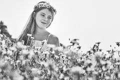 Young girl and flowers Stock Image