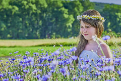 Young girl and flowers Royalty Free Stock Photos