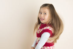 Young Girl with Flowing Hair, in Knitted Dress Royalty Free Stock Image