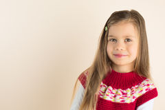 Young Girl with Flowing Hair, wearing Knitted Dress Royalty Free Stock Image