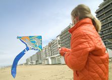 Young girl flying a kite on the beach. (Belgium/Europe Stock Photography