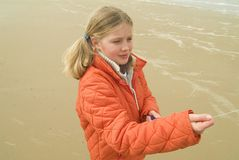Young girl flying a kite on the beach. (North sea Stock Photo