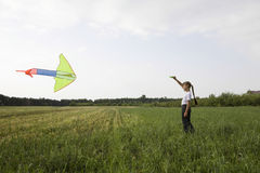Young Girl Flying Kite In Field Stock Photos