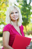 Young girl with folder Royalty Free Stock Image
