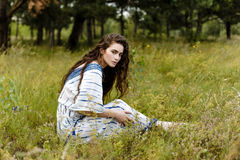 Young girl in folk clothes. Walking in fields. Fashion photo, folklore style Stock Photos