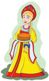 Young girl in folk dress keeps pancakes on a plate Royalty Free Stock Images