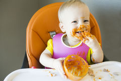 Messy baby eating royalty free stock image