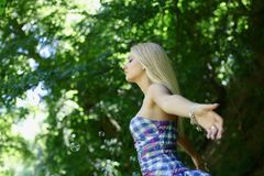 Young girl in forest Stock Photography