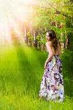 Young girl in the forest. Pretty young girl in the forest Royalty Free Stock Image