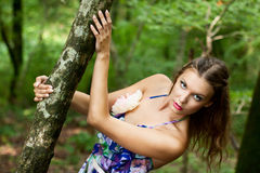 Young girl in the forest Stock Photography