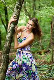 Young girl in the forest. Pretty young girl in the forest Royalty Free Stock Photos