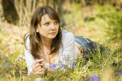 Young girl in the forest. Young girl is lying outdoors in the forest royalty free stock image