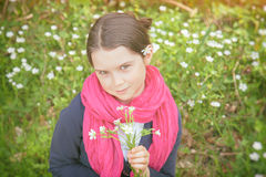 Young girl in a forest. Cute young girl in a forest wearing a pink scarf and a white flower behind her ear- vintage style Stock Photography