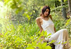 Young girl in the forest. Portrait of a beautiful young girl in the forest Royalty Free Stock Image