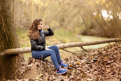 Young girl in the forest. Ranger Stock Photo