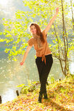 Young girl in forest. Woman posing in front of park river. Nature relax fashion beauty concept Stock Photography