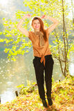 Young girl in forest. Woman posing in front of park river. Nature relax fashion beauty concept Stock Images