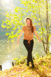 Young girl in forest. Woman posing in front of park river. Nature relax fashion beauty concept Royalty Free Stock Image